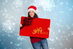 Composite image of woman holding a white sign Royalty Free Stock Images