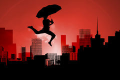 Composite image of woman jumping with umbrella Stock Images
