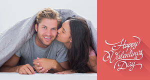 Composite image of woman kissing her husband Royalty Free Stock Photos