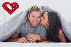 Composite image of woman kissing her husband Stock Photography