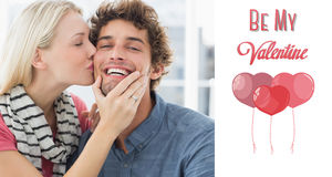 Composite image of woman kissing man on his cheek royalty free illustration