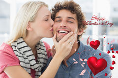 Composite image of woman kissing man on his cheek Royalty Free Stock Image