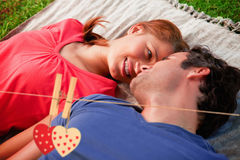 Composite image of woman looking into her friends eyes while lying on a quilt Stock Photography