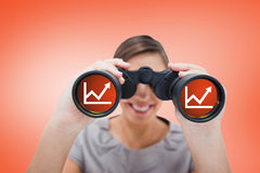 Composite image of woman looking through spyglasses Stock Photography
