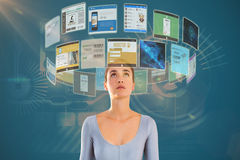 Composite image of woman looking up against white background 3d. Woman looking up against white background against technology interface 3d Stock Photos