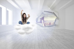 Composite image of woman looks straight ahead as she celebrates in front of her laptop Stock Photography