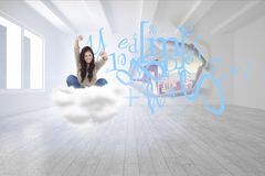 Composite image of woman looks straight ahead as she celebrates in front of her laptop Royalty Free Stock Images