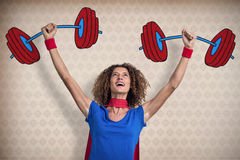 Composite image of woman pretending to be superhero Royalty Free Stock Image