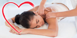 Composite image of a woman receiving a back massage royalty free illustration