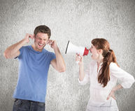 Composite image of woman shouting through a megaphone Royalty Free Stock Photos