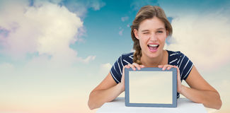 Composite image of woman showing tablet pc Stock Photos