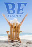 Composite image of woman sitting in deck chair at the beach with arms up Royalty Free Stock Images