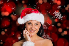 Composite image of woman smiling at the camera Stock Photo