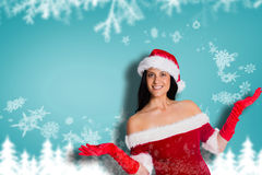 Composite image of woman smiling with hands raised Royalty Free Stock Photography
