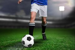 Composite image of woman soccer player progressing with a ball. Woman soccer player progressing with a ball against close-up of soccer field royalty free stock photography