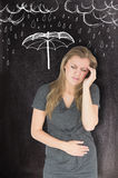 Composite image of woman with stomach ache Stock Photo