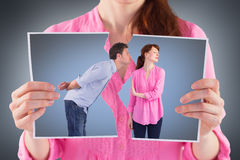 Composite image of woman stopping man from kissing Stock Photo