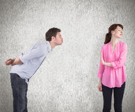 Composite image of woman stopping man from kissing Royalty Free Stock Images