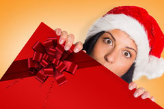 Composite image of woman surprised at the camera Stock Photography