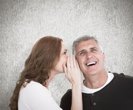 Composite image of woman telling secret to her partner Royalty Free Stock Photo