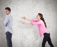 Composite image of woman trying to hug man Royalty Free Stock Photography