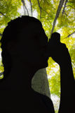 Composite image of woman using inhaler for asthma Royalty Free Stock Images