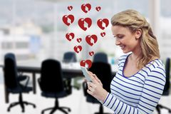 Composite image of woman using mobile phone Royalty Free Stock Images