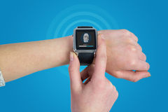 Composite image of woman using smartwatch royalty free stock photo
