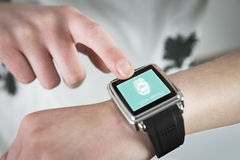 Composite image of woman using smartwatch stock images