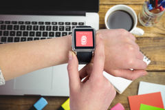 Composite image of woman using smartwatch royalty free stock images