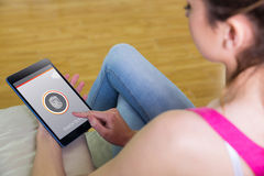 Composite image of woman using tablet at home Royalty Free Stock Photography