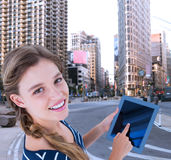 Composite image of woman using tablet pc Royalty Free Stock Image