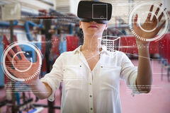 Composite image of woman using a virtual reality device Royalty Free Stock Photos