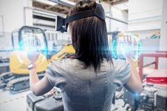 Composite image of woman using a virtual reality device stock photos