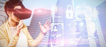 Composite image of woman using virtual reality headset. Woman using virtual reality headset against composite image of security interface stock images