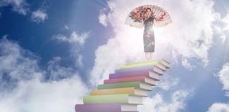 Composite image of woman wearing kimono with large fan Royalty Free Stock Photography