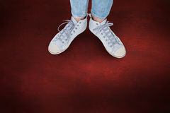 Composite image of woman wearing trainers Royalty Free Stock Image