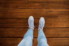 Composite image of woman wearing trainers Royalty Free Stock Photography