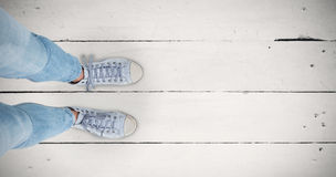 Composite image of woman wearing trainers Stock Image