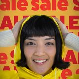 Composite image of woman wearing yellow raincoat against white background. Woman wearing yellow raincoat against white background against orange background stock image