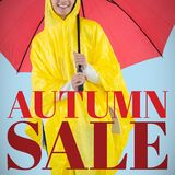 Composite image of woman in yellow raincoat holding an umbrella stock photography