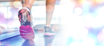 Composite image of womans feet running on the treadmill stock photography