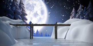 Composite image of wooden bridge over river. Wooden bridge over river against winter snow scene Stock Photography