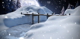Composite image of wooden bridge over river on snowcapped mountain Royalty Free Stock Images