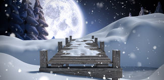 Composite image of wooden bridge on snow covered mountain. Wooden bridge on snow covered mountain against winter snow scene Royalty Free Stock Photography