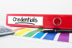 Composite image of word credentials underlined. Word credentials underlined against business desk with documents stock photo