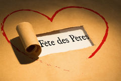 Composite image of word fete des pères. Word fete des peres against directly above shot of torn brown paper Royalty Free Stock Photo