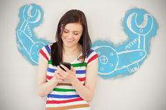 Composite image of work tool against white background. Work tool against white background against smiling girl using her mobile phone Stock Images