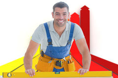 Composite image of worker using spirit level Royalty Free Stock Images