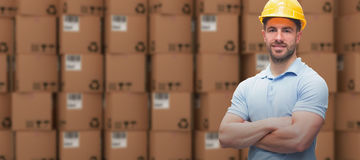 Composite image of worker wearing hard hat in warehouse Royalty Free Stock Photo